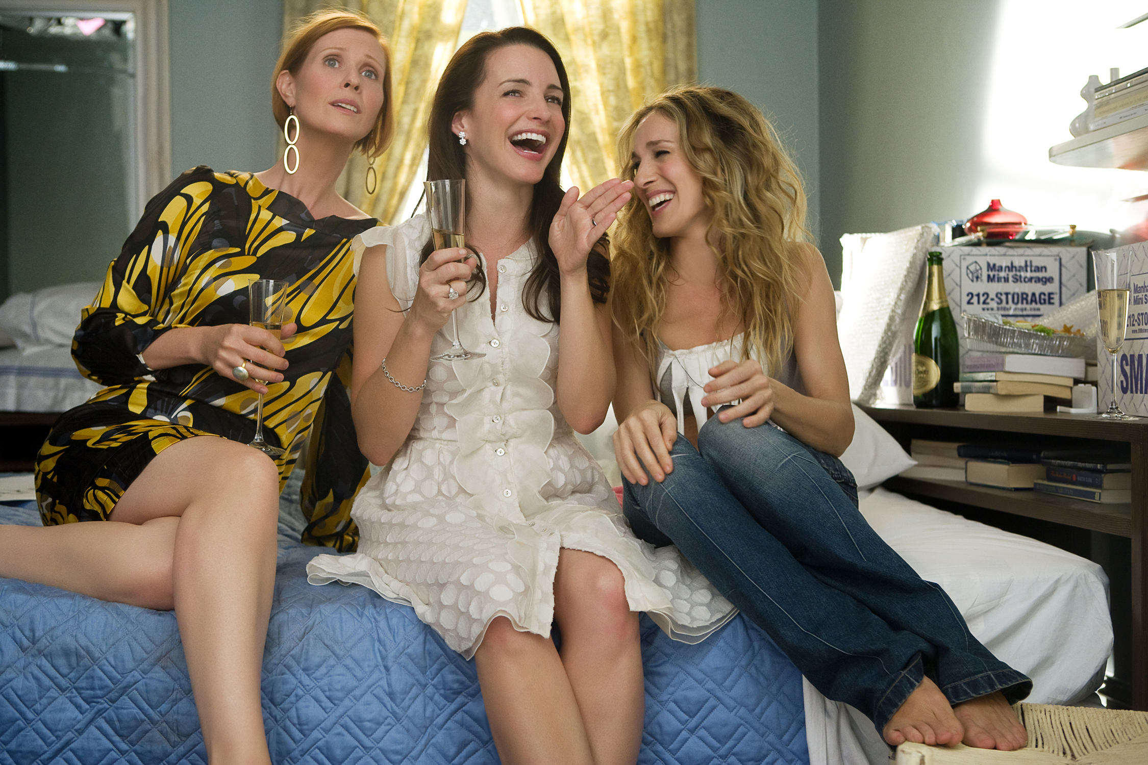 """NEW LINE CINEMA  5/25/08 The gang is back for fresh laughs. Miranda, Charlotte and Carrie (from left, Cynthia Nixon, Kristin Davis and Sarah Jessica Parker) star in the much-anticipated movie version of """"Sex and the City."""" """"It felt like we had been apart about a week,"""" said Davis. EXXSATCm - SEX AND THE CITY - Cynthia Nixon (left) stars as """"Miranda Hobbes"""", Kristin Davis (center) stars as """"Charlotte York-Goldenblatt"""" and Sarah Jessica Parker stars as """"Carrie Bradshaw"""" in New Line Cinema's upcoming release of SEX AND THE CITY: THE MOVIE. Photo Credit: Craig Blankenhorn/New Line Cinema. Maximum width 67.5 picas at 200 dpi. 3/31//08"""